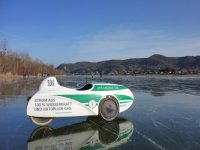 Velomobile sinner mango on frozen danube